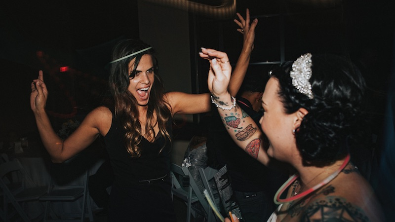 Guests dancing at a WGW Media wedding event.